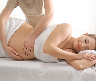 Pregnant woman being massaged