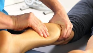 Therapist doing sports massage